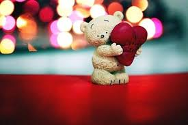 love-teddy-bear-holding-heart