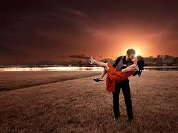 love-man-lifting-woman-in-red-dress